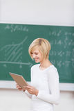 Female Student Using Digital Tablet In Classroom Royalty Free Stock Photo