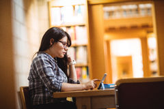 Female student using digital tablet Stock Image