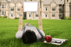Female student using a digital tablet outdoor Royalty Free Stock Photos