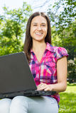 Female student using laptop Stock Image