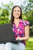 Female student using laptop Stock Image