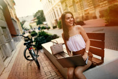 Female student using laptop outdoors. And studying Stock Photo