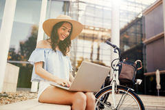 Female student using laptop outdoors. And studying Stock Photography