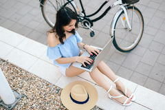 Female student using laptop outdoors Royalty Free Stock Images