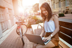 Female student using laptop outdoors Royalty Free Stock Image