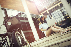 Female student using laptop outdoors Royalty Free Stock Photo