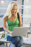 Female student using laptop outside royalty free stock photography