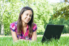 Female student using laptop Stock Photography