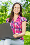 Female student using laptop Royalty Free Stock Images