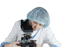 Female student using a microscope Stock Photo