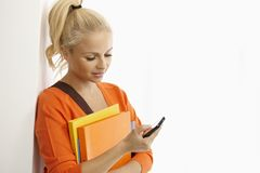 Female student using mobile phone Royalty Free Stock Photos