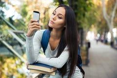 Female student using smartphone Stock Photo