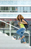 Female student walking up stairs to college. Portrait of a female student walking up stairs to college Stock Image