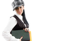 Female student wearing cap holding books Royalty Free Stock Photos