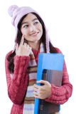 Female student with winter clothes Royalty Free Stock Images