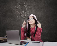 Female student in winter clothes in class Stock Images