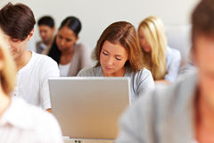 Female Student Working At Laptop Stock Photos
