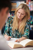 Female Student Working In Classroom. Female Student Works In Classroom Stock Photo