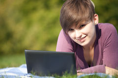 Female student working on laptop Royalty Free Stock Photo