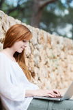Female student working on a laptop Royalty Free Stock Photos