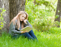 Female student working in park Stock Image