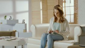 Female student working on project, using tablet PC at home. Stock footage stock footage