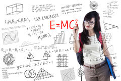 Female student writes formula Royalty Free Stock Photography