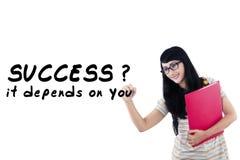 Female student writes motivation word 3 royalty free stock photos
