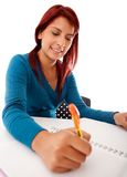 Female student writing Stock Photography