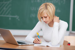 Female student writing concentrated royalty free stock photography