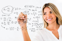 Female student writing formulas Stock Photography
