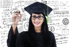 Female student writing math formulas Royalty Free Stock Photo