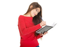 Female student writing in notebook. Stock Photography