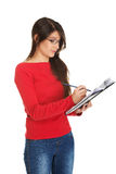 Female student writing in notebook. Stock Photo