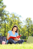 Female student writing in a notebook outdoors Royalty Free Stock Photos