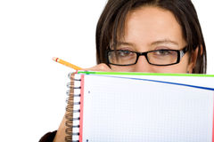 Female student writing on notepad Stock Images