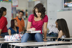 Female Student Writing Notes In Classroom Stock Photography