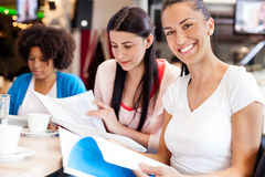 Female students in cafe Royalty Free Stock Image