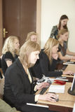 Female students in classroom Royalty Free Stock Images
