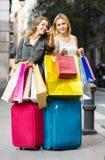 Female students having shopping Stock Photo