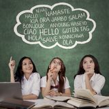 Female students learn different languages stock photography