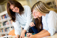 Female students at the library Stock Photos