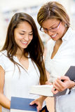 Female students at the library Royalty Free Stock Image