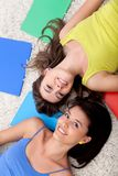 Female students lying on the floor Royalty Free Stock Images