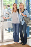 Female students opening door Royalty Free Stock Photography