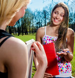 Female students outdoors Royalty Free Stock Photos
