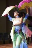 Female students perform folding fan dance Stock Image
