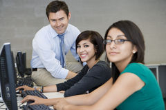 Female Students With Professor In Computer Lab Stock Photography