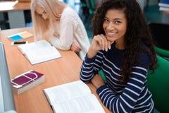 Female students reading books in university. Portrait of a happy female students reading books in university Stock Images