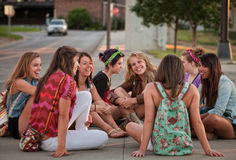 Female Students Sitting on the Ground Royalty Free Stock Photography